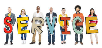 Diverse Group of People Holding Text Service.  stock photo