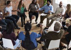 Diverse group of people in a seminar stock images