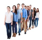 Diverse group of people standing in row. Isolated on white Stock Image