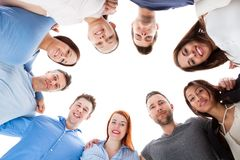 Diverse group of people standing together. Isolated on white Stock Photography