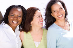 Diverse group of people talking and laughing. Happy diverse group of women laughing and smiling Stock Photos
