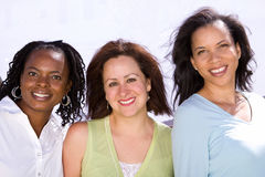 Diverse group of people talking and laughing. Happy diverse group of women laughing and smiling Stock Image