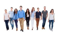 Diverse group of people walking towards camera. Isolated on white Stock Photo