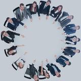 Diverse group pf young business people seated round a table disc Stock Images