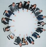 Top view of smilimg business team, sitting at a round table on w Royalty Free Stock Photography