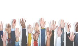 Diverse group of raised hands on white background stock photography
