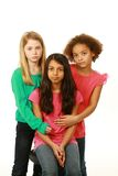 Diverse group of serious young girls. Diverse group of sad preteen girls Royalty Free Stock Images