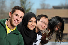 Diverse Group of Students. Smiling with selective focus on foreground person Stock Photos