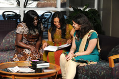Diverse Group of Students in traditional attire Royalty Free Stock Photos