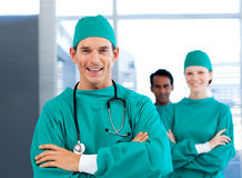 A diverse group of surgeon smiling Stock Photos