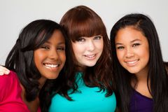 Diverse group of teens girls smiling. Diverse group of teens girls smiling  on white Stock Photos