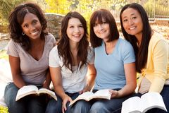 Diverse group of women talking and laughing. Beautiful diverse group of women talking and laughing stock photos