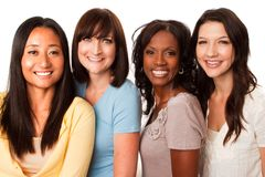 Diverse group of women talking and laughing. Beautiful diverse group of women talking and laughing royalty free stock photography