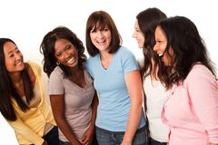 Diverse group of women talking and laughing. Beautiful diverse group of women talking and laughing royalty free stock images