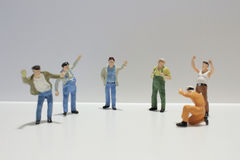 Diverse group of workers standing in a row against Royalty Free Stock Image
