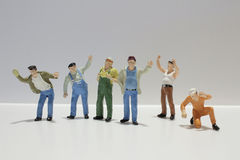 Diverse group of workers standing in a row against Royalty Free Stock Photo