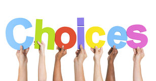 Diverse Handen die de Word Keuzen houden Stock Fotografie