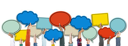 Diverse Hands Holding Colourful Speech Bubbles Royalty Free Stock Photo