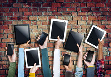 Diverse Hands Holding Digital Tablet and Mobile Phone Stock Photography