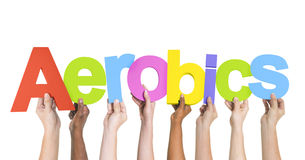 Diverse Hands Holding the Word Aerobics Stock Photo