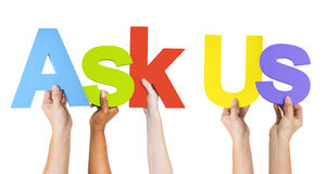 Diverse Hands Holding the Word Ask Us Stock Photo