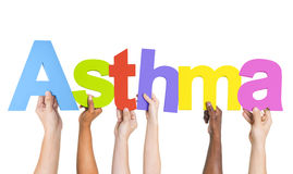 Diverse Hands Holding The Word Asthma.  Royalty Free Stock Images