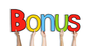 Diverse Hands Holding the Word Bonus Royalty Free Stock Photo