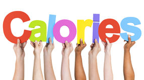 Diverse Hands Holding The Word Calories.  stock photo