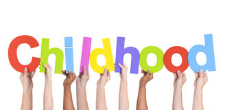Diverse Hands Holding The Word Childhood Royalty Free Stock Photography