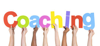 Diverse Hands Holding The Word Coaching Stock Image