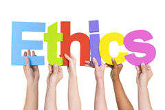 Diverse Hands Holding The Word Ethics.  Stock Photos