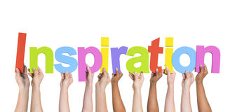 Diverse Hands Holding the Word Inspiration.  royalty free stock photo