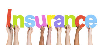 Diverse Hands Holding The Word Insurance.  Stock Images