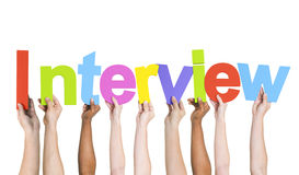 Diverse Hands Holding the Word Interview Royalty Free Stock Photos