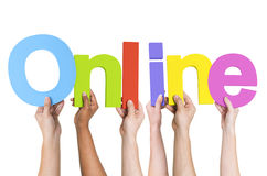 Diverse Hands Holding The Word Online.  Royalty Free Stock Photo