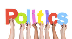 Diverse Hands Holding The Word Politics Royalty Free Stock Photography
