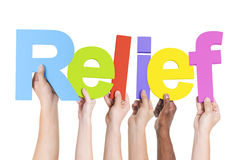 Diverse Hands Holding the Word Relief.  royalty free stock images