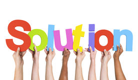 Diverse Hands Holding The Word Solution Royalty Free Stock Photos