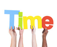 Diverse Hands Holding the Word Time.  Royalty Free Stock Photography
