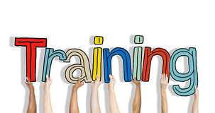 Diverse Hands Holding the Word Training stock illustration