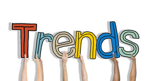 Diverse Hands Holding the Word Trends Royalty Free Stock Image