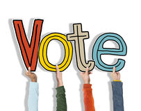 Diverse Hands Holding Word Vote Concept Stock Photography