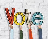 Diverse Hands Holding the Word Vote Concept. Diverse Hands Holding the Word Vote Stock Images