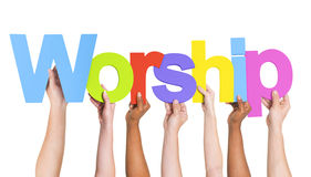 Diverse Hands Holding The Word Worship Stock Photo