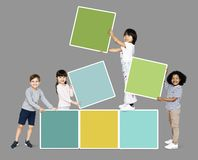 Diverse happy kids stacking empty square boards royalty free stock image