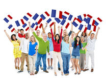 Diverse Happy People Holding Flag of France Stock Image