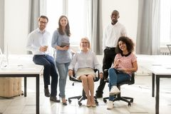 Diverse happy staff employees group posing for portrait in office stock image