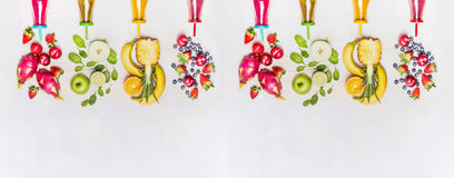 Diverse healthy fruits smoothies with colorful ingredients  on white wooden background, top view, banner. Stock Photos