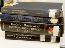 Diverse human rights books law education university eam Stock Photos
