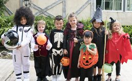 Diverse kids in Halloween costumes royalty free stock photography